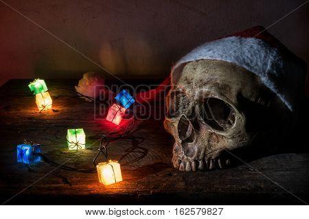 Still Life Skull Wear Santa Claus Hat With Gift Blinker Light.