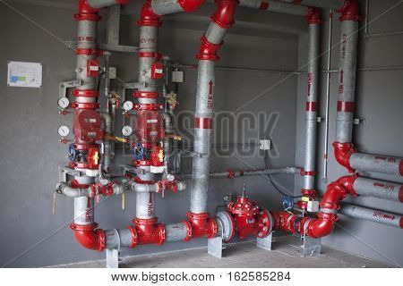 Heating system's cooper pipes with ball valves on a white wall
