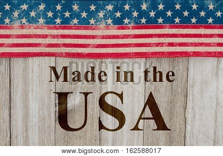 Made in America message USA patriotic old flag and weathered wood background with text Made in the USA