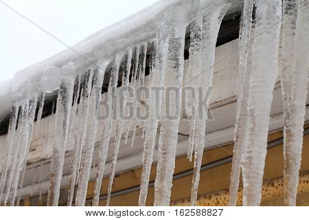 Icicles on the roof. cold winter weather concept, soft focus, shallow depth of field. macro view
