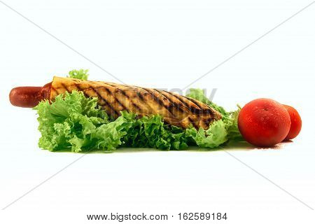 French hotdog isolated wil leaf of salad and two tamotas wit drop of water