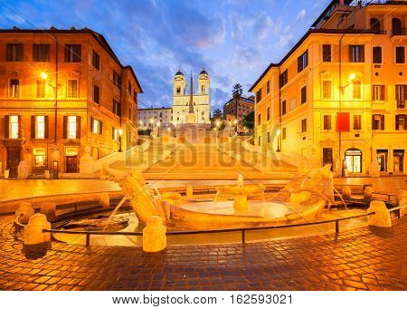 Spanish Steps with boat fountain illuminated at blue night, Rome, Italy