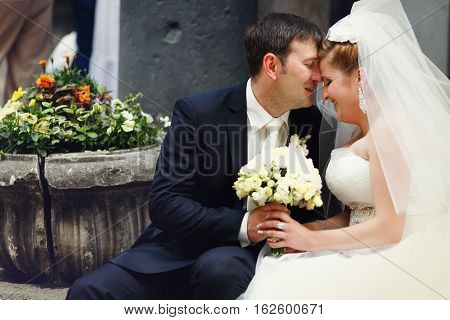 A Lifelong Moment - Groom Kisses Bride's Forehead