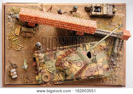 Two german officers conversation in front of european yard. World War 2 time. Miniature. Top view