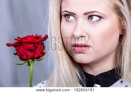 Beautiful Blonde Woman Holding Red Rose