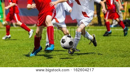 Soccer Players Kicking Ball. Chidren Playing Football Soccer Game on Sports Field. Boys Play Soccer Match on Green Grass. Youth Soccer Tournament Teams Competition