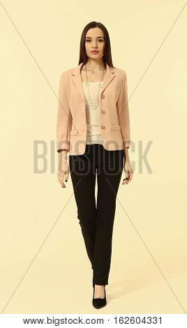 Pink Jacket And Trousers On Woman