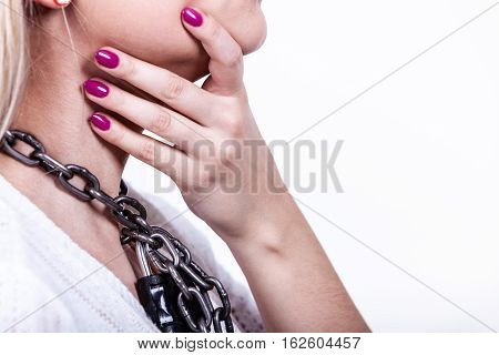 Slavery lack of freedom speech social problems anxiety sore throat no human rights concept. Woman having heavy chain with padlock on neck.