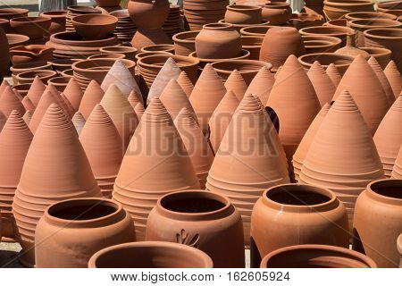 Pieces of pottery spread out to dry in the courtyard under the summer sun