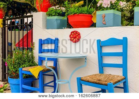 Beautiful bright chairs in the courtyard, a traditional Greek view, Kos island, Dodecanese, Greece