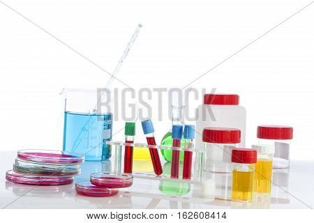 several tubes with blood tubes, plates petri and the background tubes with urine samples