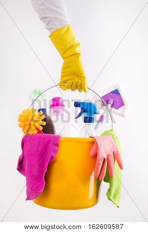 Woman Holding Basket With Cleaning Products