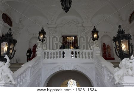 VIENNA, AUSTRIA - JANUARY 1 2016: The grand staircase of Schloss Belvedere in Vienna with some people around
