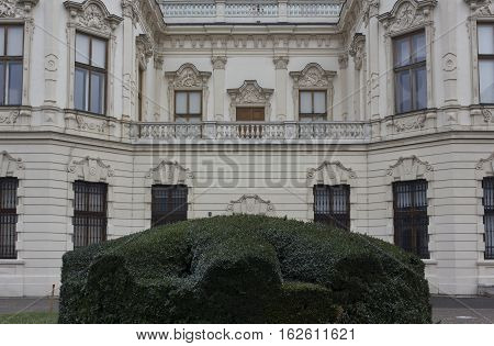 VIENNA, AUSTRIA - JANUARY 1 2016: Backside of the facade of Shloss Belvedere building in Vienna with an hedge in the middle nobody around