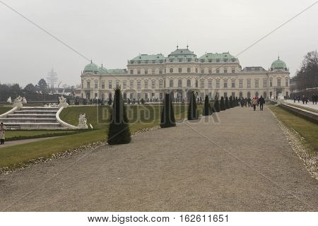 VIENNA, AUSTRIA - JANUARY 1 2016: Side view of Schloss Belvedere park and building in Vienna in a winter foggy day