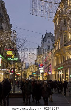 VIENNA, AUSTRIA - JANUARY 1 2016: view of Kartner street in Vienna at winter time with Christmas decoration and many people around