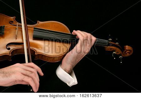 Violinist Plays The Violin. Music. On A Black Background.