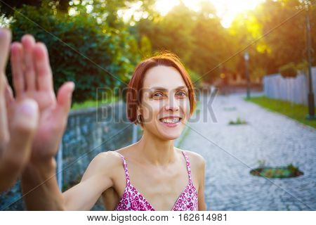 Woman On The Street Gives A High Five.