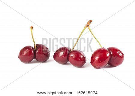 Mutated cherries on white background in studio