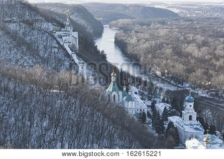 Siversky Donets River winter. On the left the Churches of Sviatohirsk Lavra