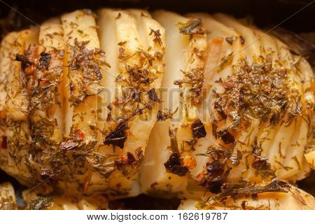 Hasselback potatoes in a baking dish up view