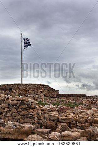 Greece flag in the wind-paced evening on the Acropolis.