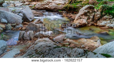 Creek.Landscape of  a creek. Scenic view of a creek at the mountain foot.
