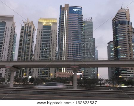 DUBAI, UAE - DEC 10: View of Sheikh Zayed Road skyscrapers in Dubai, UAE on Dec 10, 2016. Sheikh Zayed Road (E11 highway) is home to most of Dubai's skyscrapers, including the Emirates Towers.