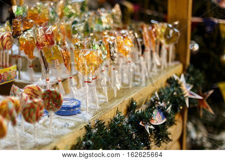 Caramel on stick on night fair in New Year night