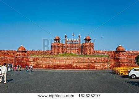 DELHI INDIA - September 18 2013: The Red Fort on Sept 18 2013 in Delhi. Red Fort is a 17th century fort complex was designated a UNESCO World Heritage Site in 2007. It covers area of about 121.34 acres.