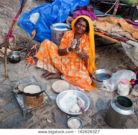 JAIPUR INDIA-SEPT 26 : Indian woman preparing a meal on the street on the way to Surya Mandir or Temple of the Sun God September 26 2013 in Jaipur Rajasthan India.