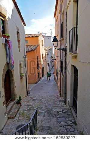 Back street in the medieval walled town Vila Vella in Tossa de Mar, Spain