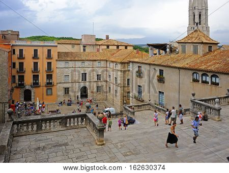 Girona,  Spain - August 2, 2014 : Visitors explore the medieval district of Girona
