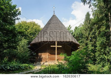Lviv Ukraine - September 09 2016: Ancient Ukrainian wooden church of Holy Trinity from Klokuchka village suburb of Chernivtsi (1774). Museum of Folk Architecture in Lviv Ukraine