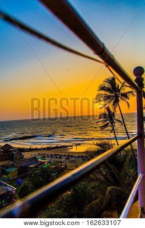 Palm beach on sunset, Anjuna, Goa, India