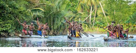 Canoe War Ceremony Of Asmat