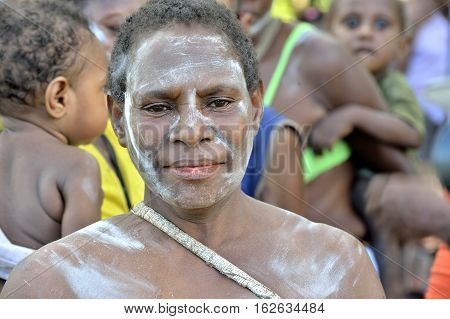 YOUW VILLAGE ATSY DISTRICT ASMAT NEW GUINEA INDONESIA - MAY 23: Portrait of an elderly papuan woman from the tribe of Asmat. Small village on the deep jungle of New Guinea. Indonesia. May 23 2016
