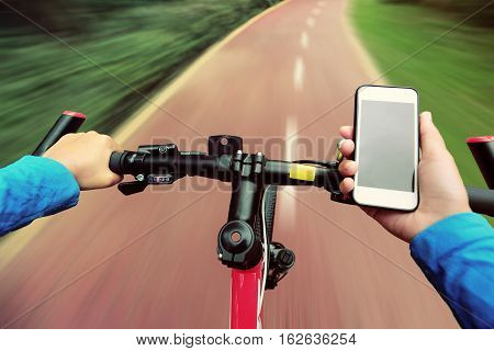 use smarphone app for navigation while bike ride in the forest trail