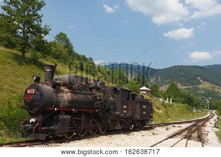 Steam Locomotive On Railroad
