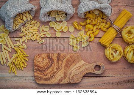 Italian Foods Concept And Menu Design . Various Kind Of Pasta Elbow Macaroni ,farfalle ,rigatoni ,gn