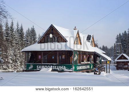 SLOVAKIA LYSA POLANA - JANUARY 05 2015: Product shop in traditional wood cottage near polish-slovak border on the road from Zakopane (Poland) to Tatranska Lomnica (Slovakia) in High Tatras mountains