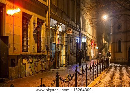 POLAND KRAKOW - JANUARY 01 2015: Podbrzezie (Embankment) Street in Krakow at night. Built of 1869 in place of a dirt road running along the bed of the Old Vistula . The current name from the XIX c.