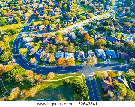 Real Estate Back of Community with Colorful Leaves turning colors for Fall Autumn Texas Hill Country Neighborhood Suburb Home Development