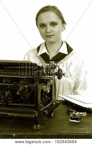 Nice girl for a vintage typewriter in a retro style on a white background