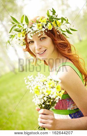 Portrait of beautiful summer girl in flower crown