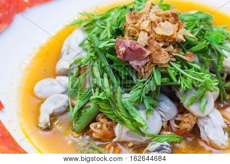 Spicy Oysters Salad with Young Tamarind Leafs