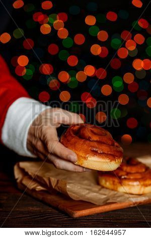 Cinnamon rolls and spices. Hands in the frame
