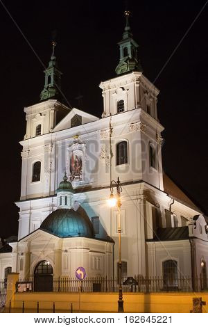 Collegiate Church of St. Florian in the historical part of Krakow at night. Church was built between 1185 and 1216. Present appearance is the result of a Baroque renovation.