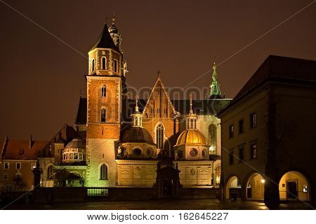 View of the Wawel Royal Archcathedral Basilica of Saints Stanislaus and Wenceslaus as part of Wawel castle architectural complex on the Wawel Hill at winter night Krakow Poland.