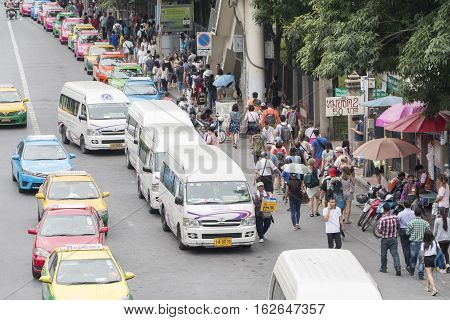 Bangkok Thailand - November 07 2015: van taxis taxis and people crowd on street at jatuchak market. Jatujak is the largest market in Thailand and the world's largest weekend market.